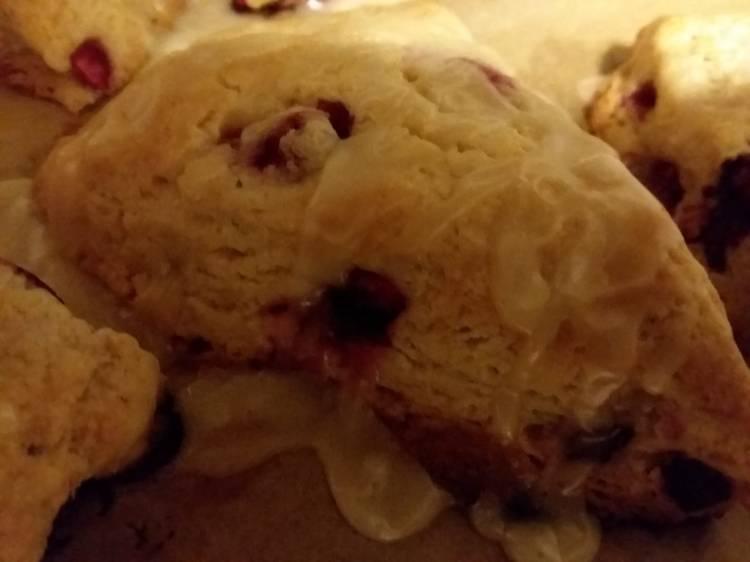 A close up o cranberry orange scones.