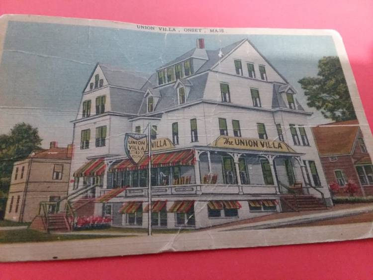 Picture of an old postcard of an old hotel.