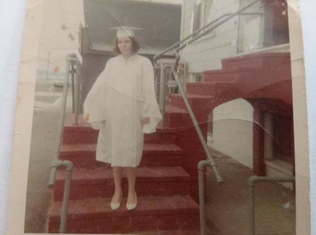 picture of the writer in a white cap and gown on the steps of the Union Villa June 1968,