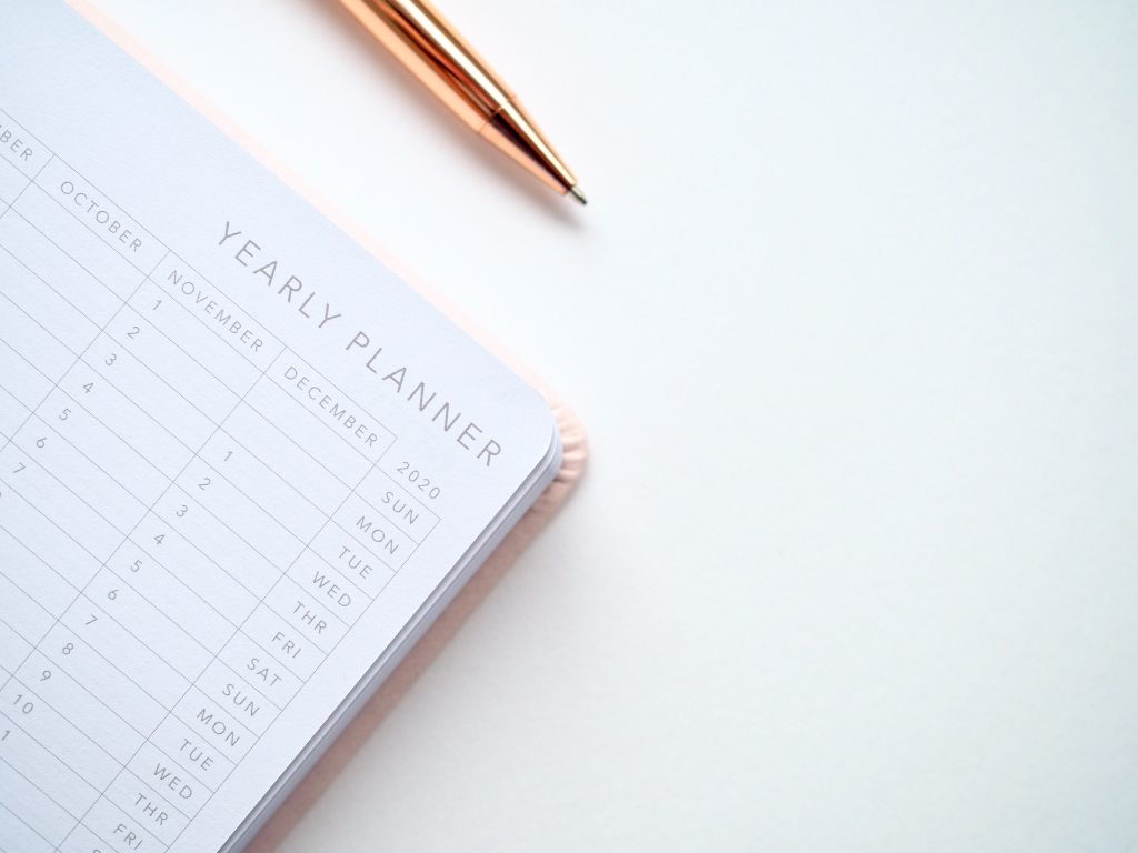 picture of a yearly planner with a pen