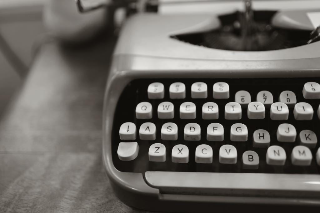picture of a manual typewriter with some stuck keys