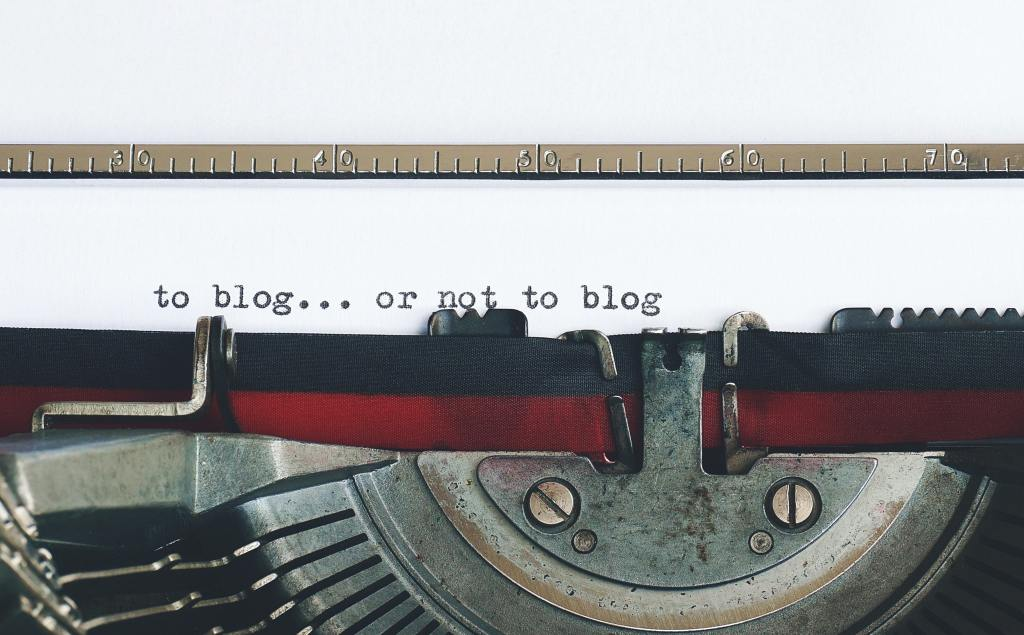close up picture of a old fashioned typewriter, with words on the page,' to blog...or not to blog