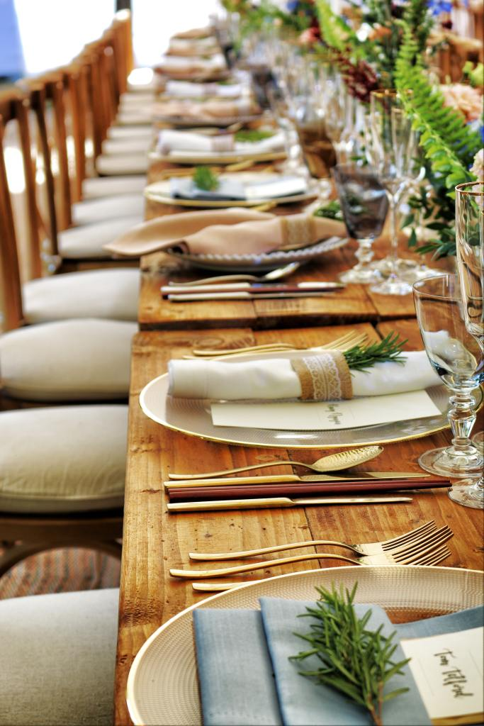 Picture of a banquet table with place settings