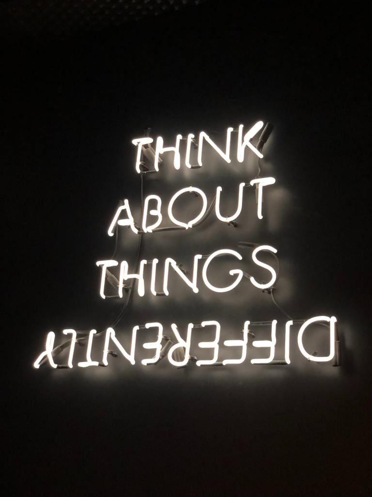 picture of a neon sign with words