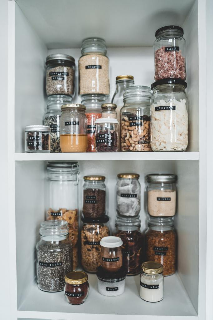 picture of glas jars and bottles on shelves