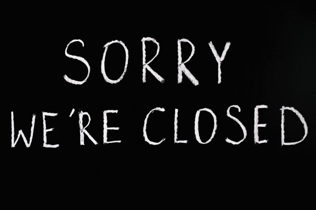 "Black background white letters that say ""Sorry we Are Closed"""