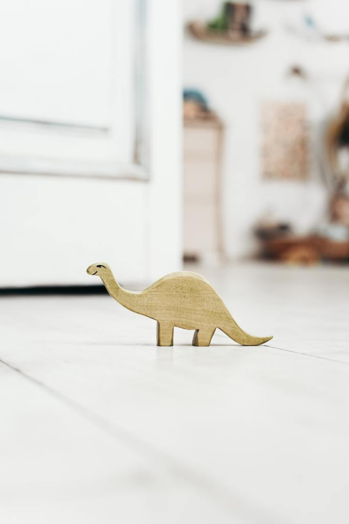 Picture of a toy dinosaur on a white floor